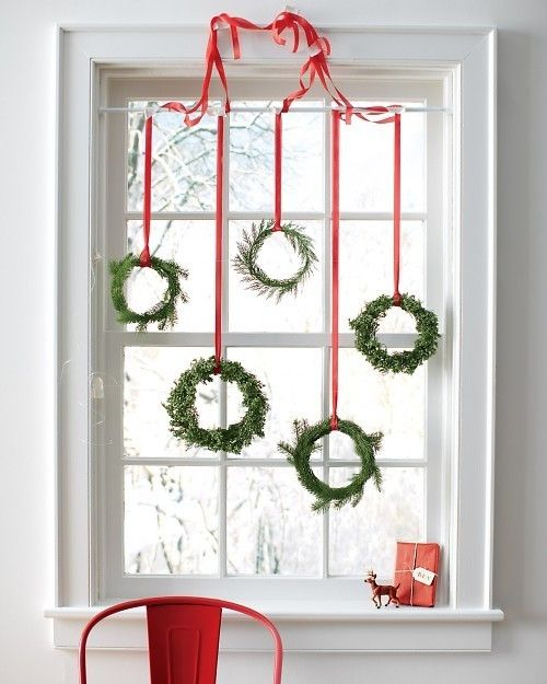 Lovely-Green-Wreaths-Hung-on-Window's-Top